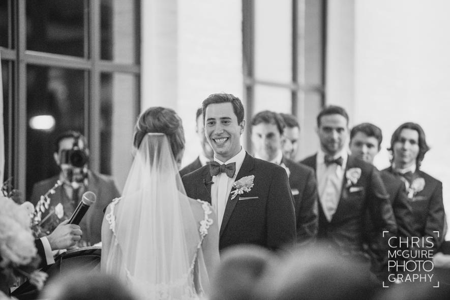 groom smiling indoor wedding