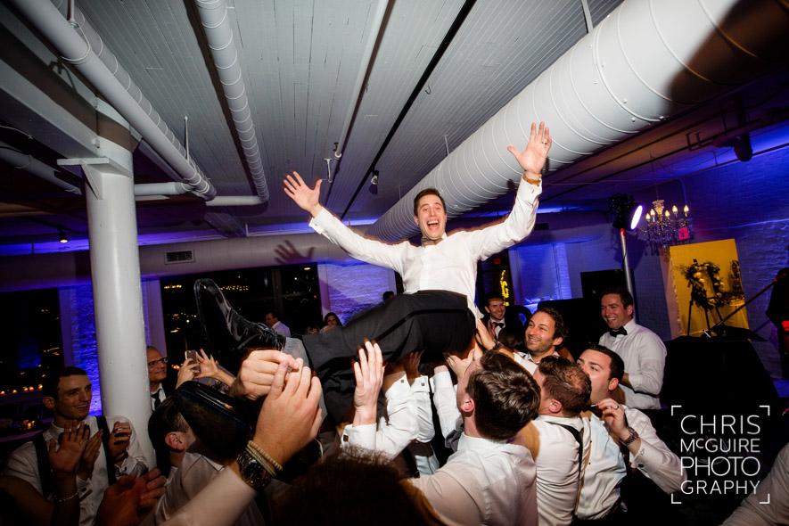 groom flying wedding dance