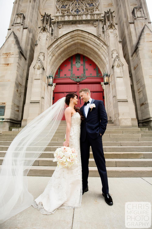 bride groom red door veil flying