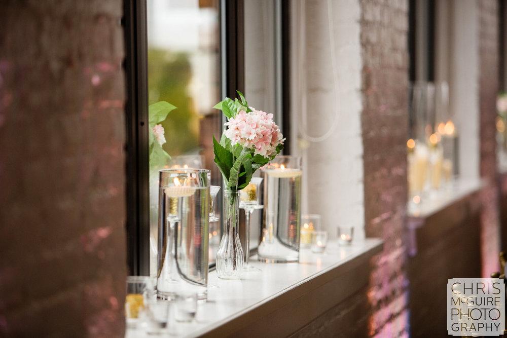 flower in window at wedding reception