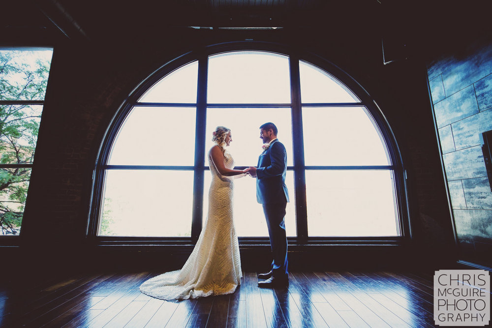 bride and groom portrait in front of window