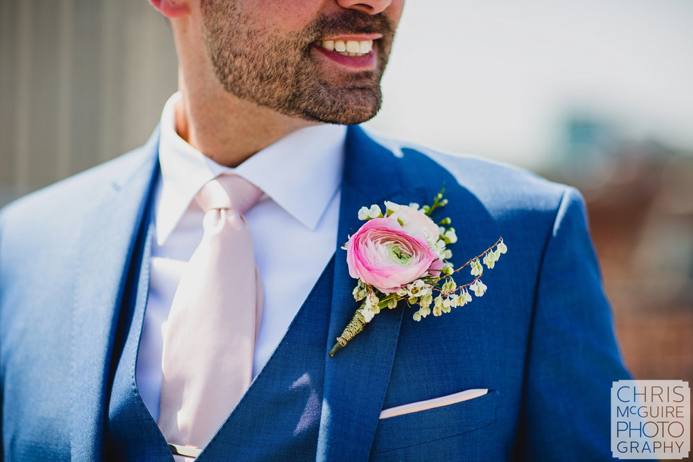 groom blue suit pink flower boutonniere