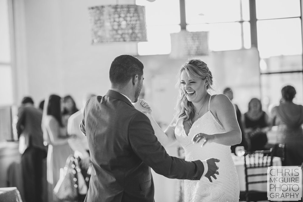 bride laughing during first dance