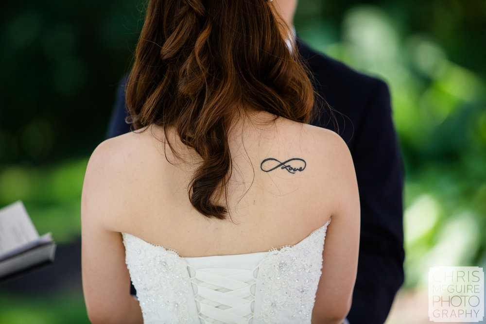 love tattoo on bride's back