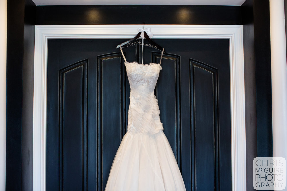 wedding dress on black door