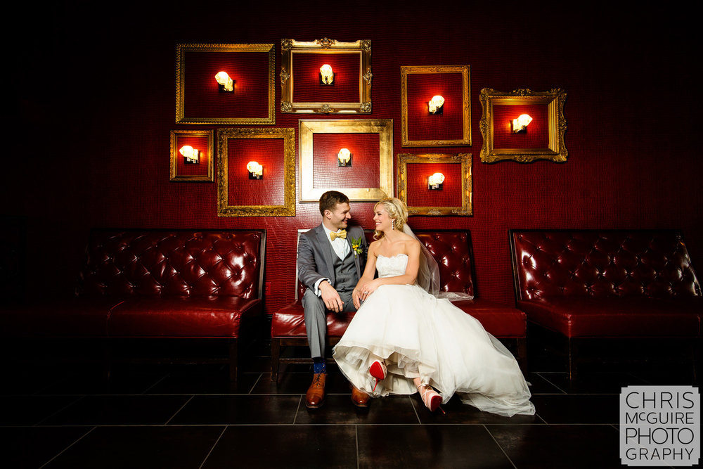 bride groom with red wall