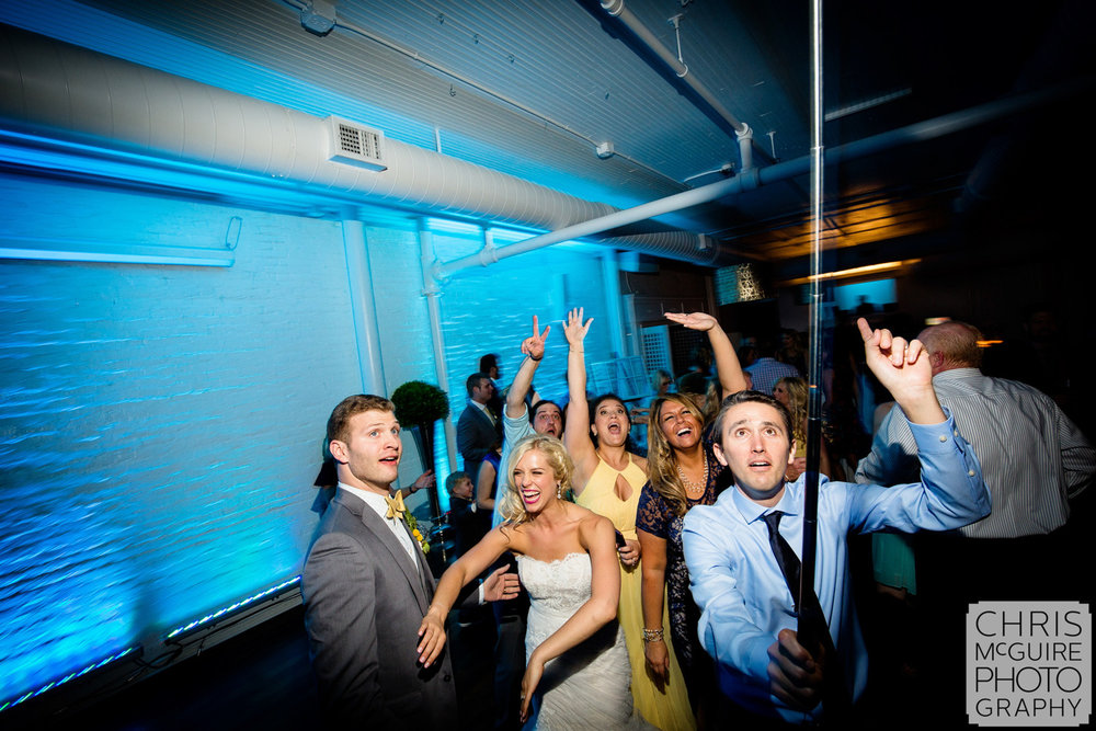 selfie stick at wedding reception