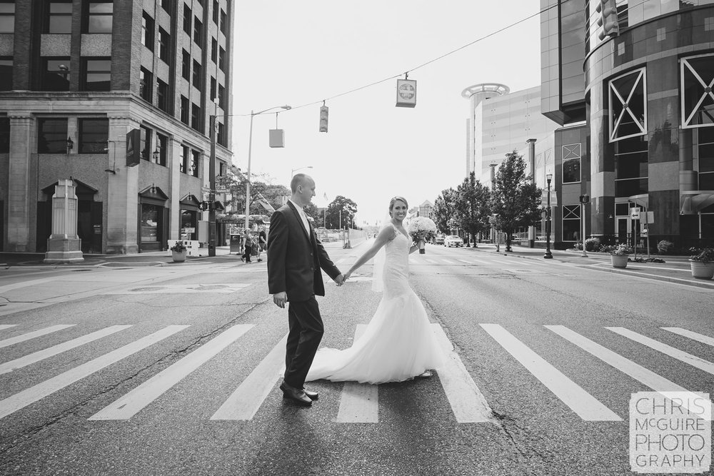 bride groom crossing street in downtown kalamazoo