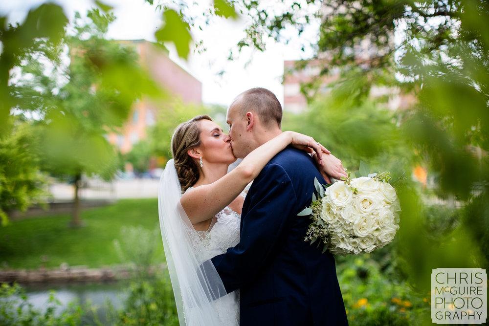 bride groom kiss among trees