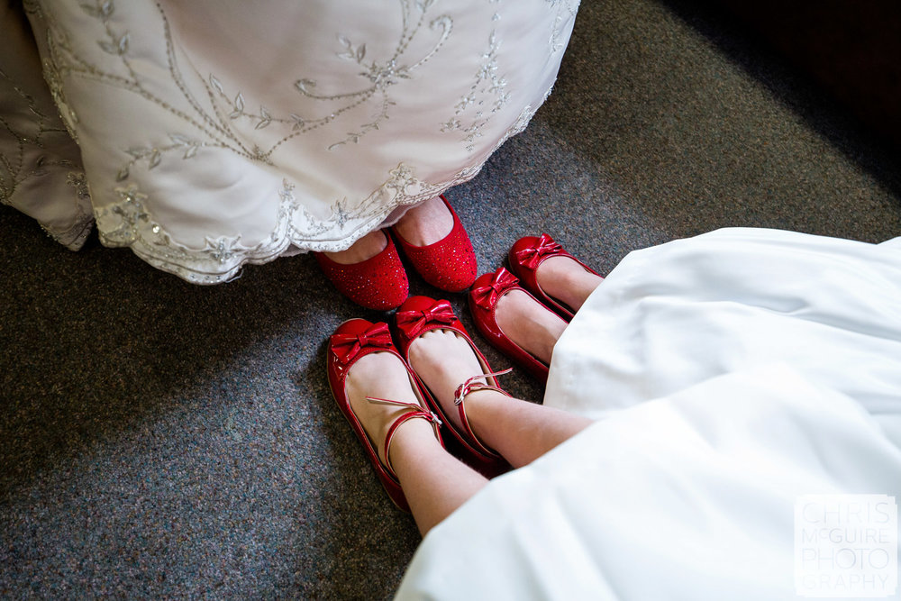 bride flower girls with red shoes
