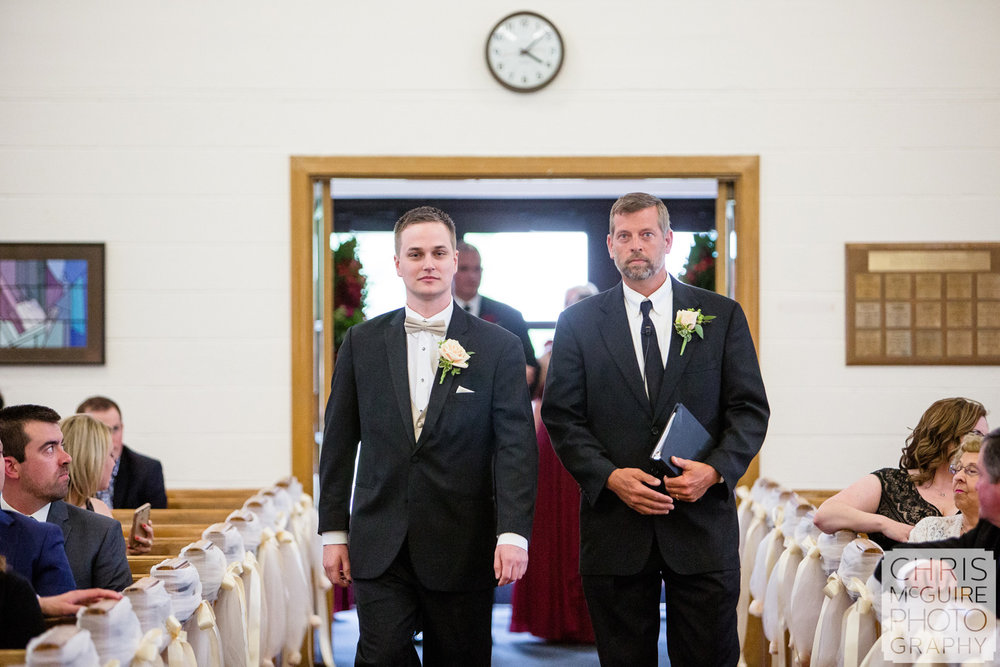 groom walks down aisle for wedding ceremony