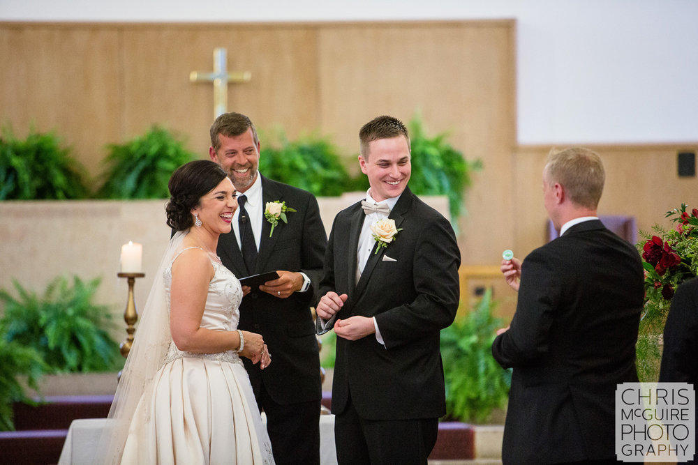 bride groom laugh during wedding ceremony
