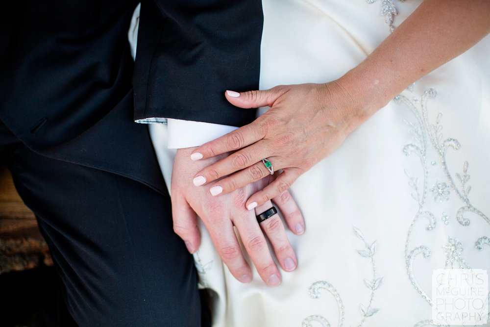 bride groom hands with wedding rings