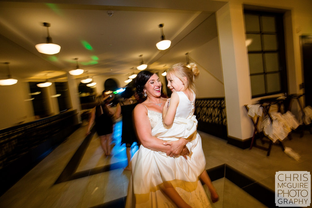 bride dances with flower girl at wedding reception in peoria illinois