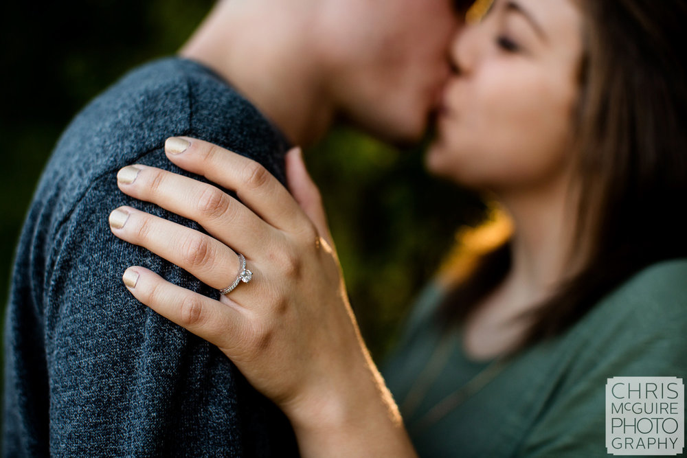 peoria engagement ring couple kissing