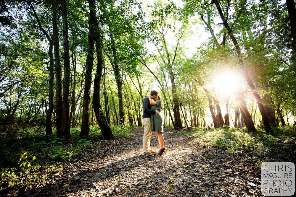 peoria il engagement portriat couple kissing in woods