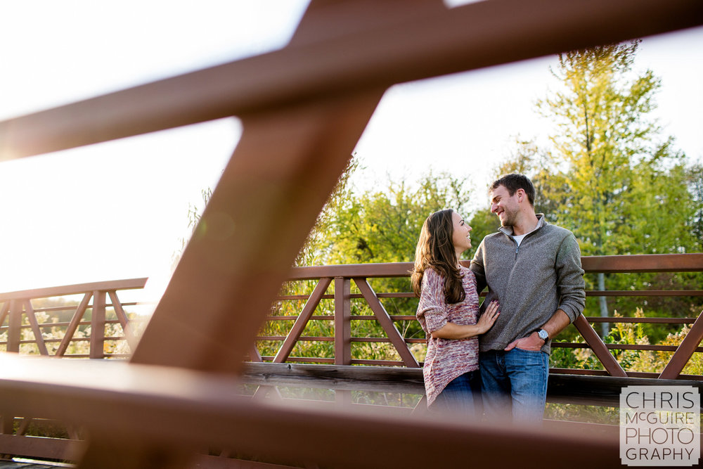 couple on bridge urbana engagement photography