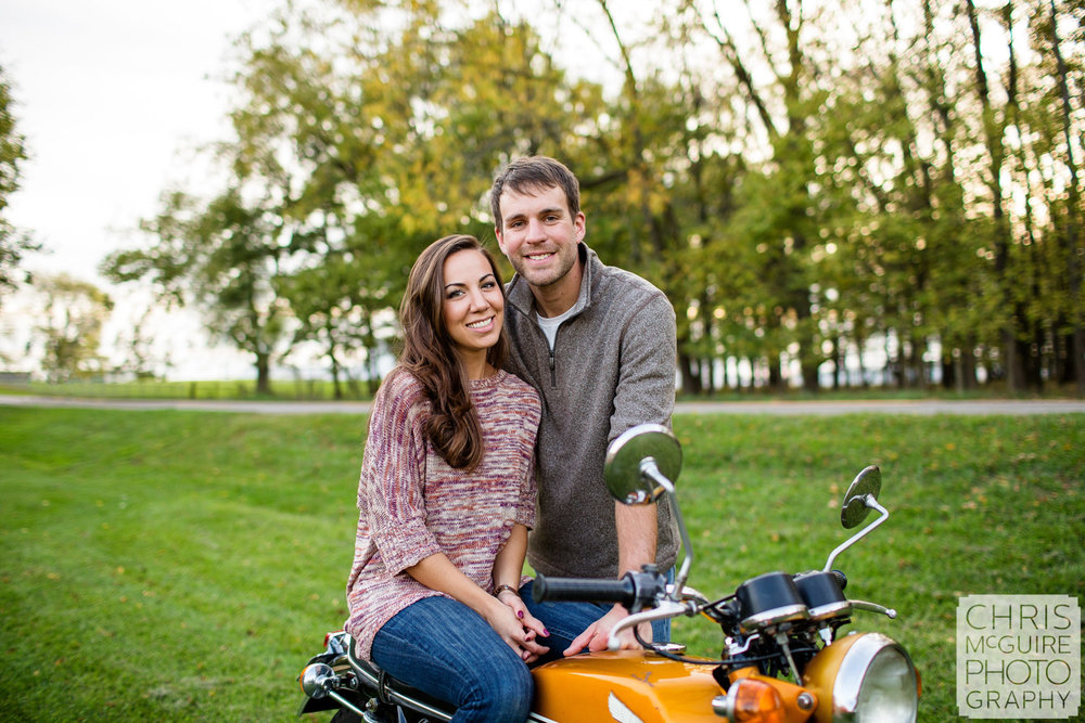 engagement couple with honda motorcycle