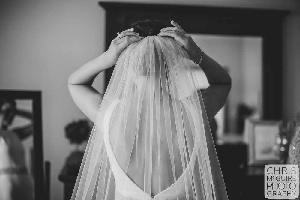 bride adjusting veil peoria illinois wedding photographer