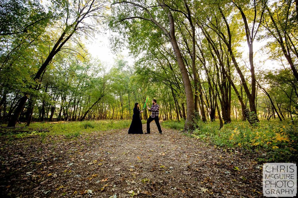 light saber engagement session in woods