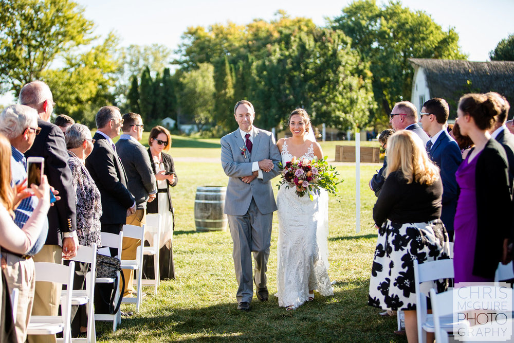 bride and father walking down aisle outdoor wedding