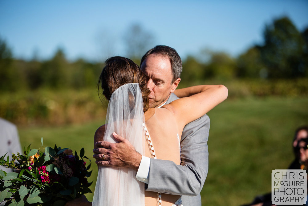 bride hugs father at wedding