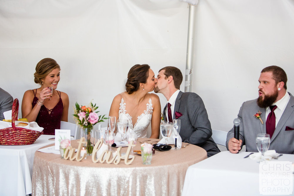 bride groom kiss at reception