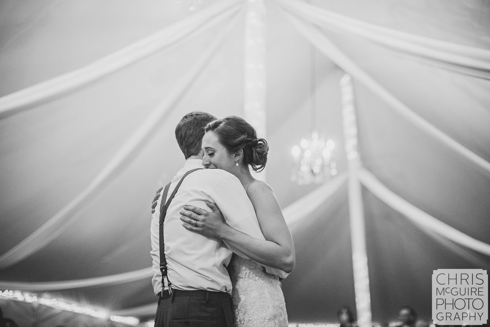 bride groom first dance in tent reception
