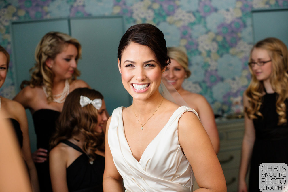 bride smiling while getting ready for wedding peoria