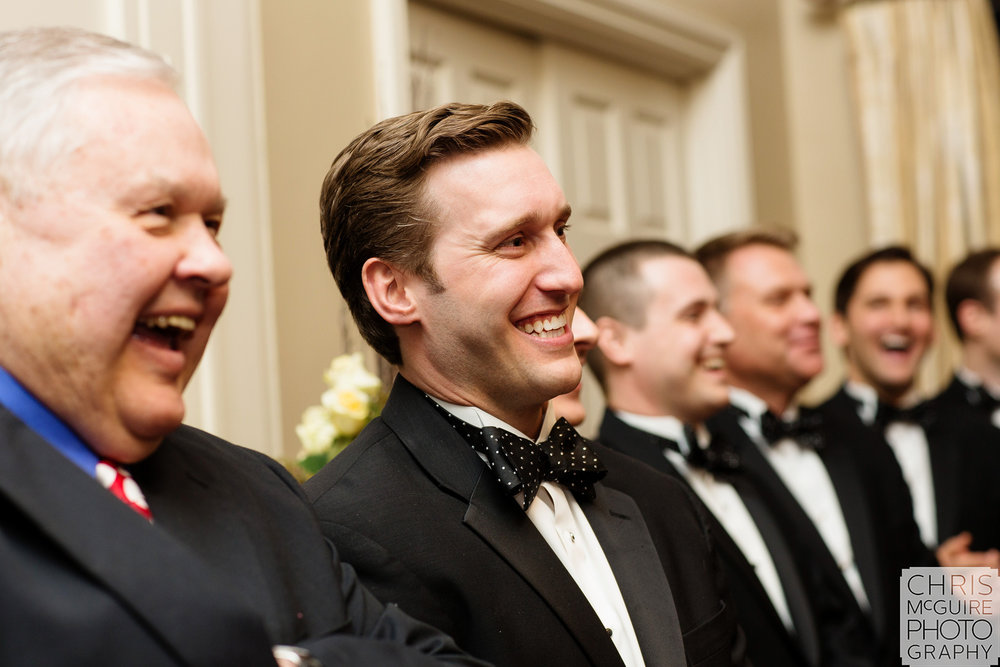 groom smiling at alter