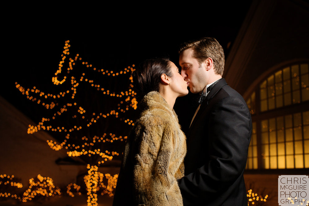 bride groom kiss outside winter wedding fur