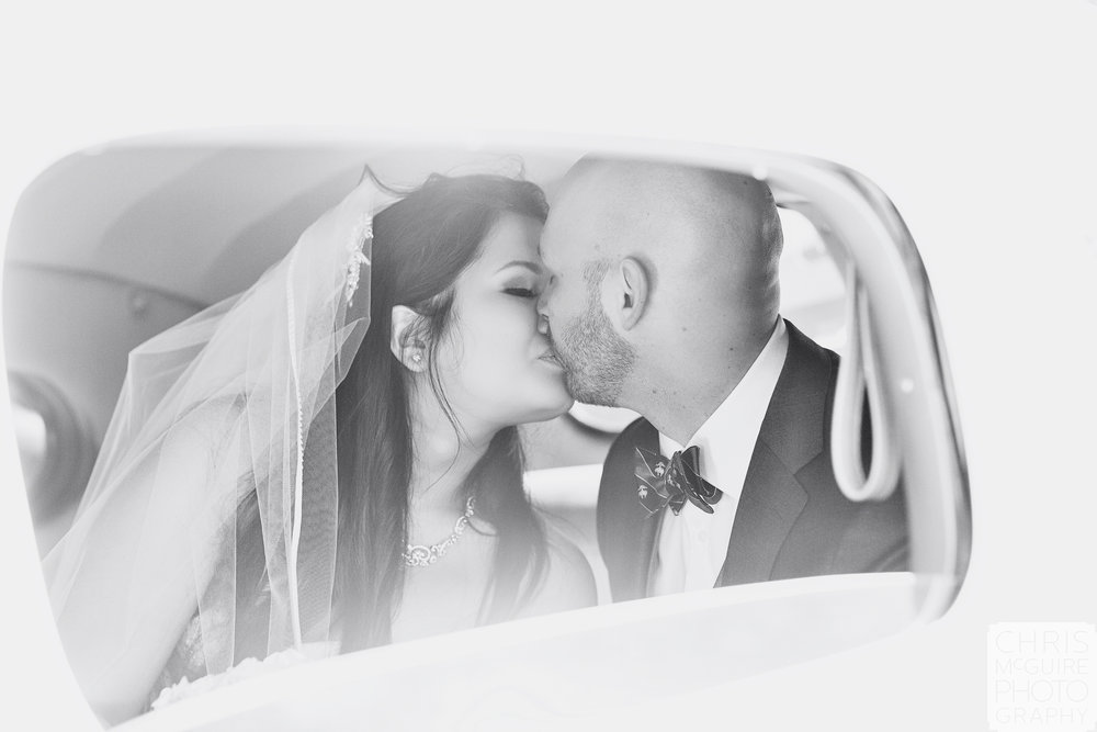 Central Illinois Wedding Photographer bride groom kiss in packard