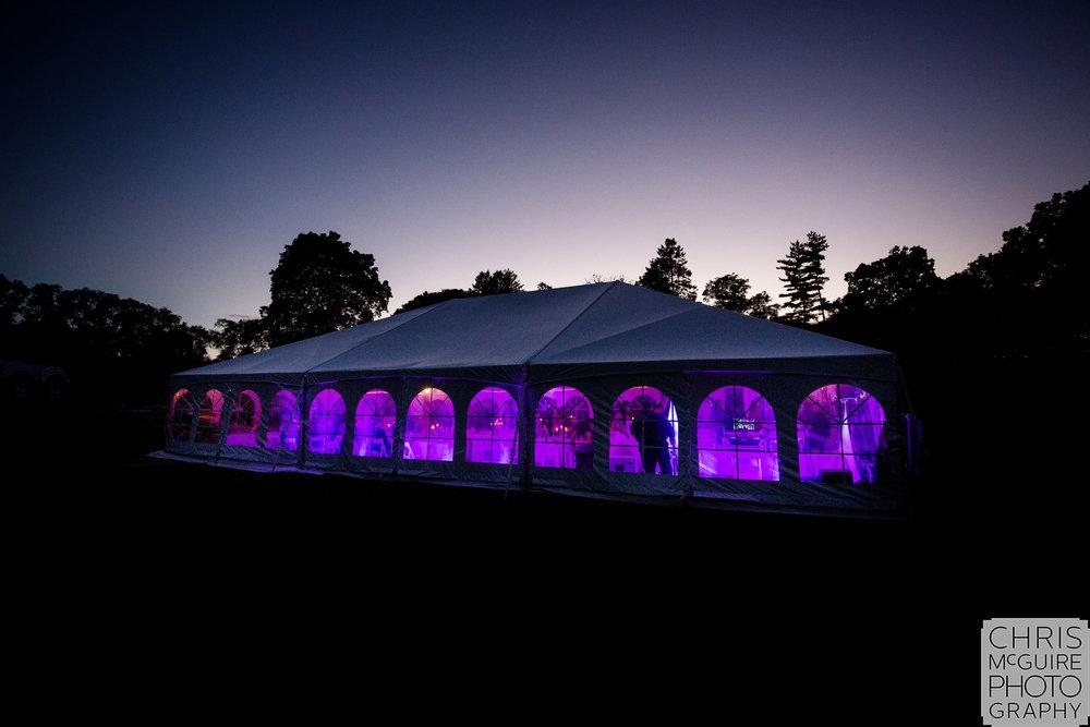 wedding reception tent at dusk