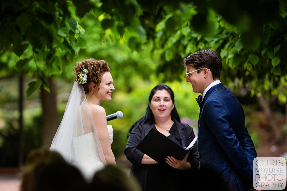 bride and groom smile at Chicago Botanic Gardens wedding