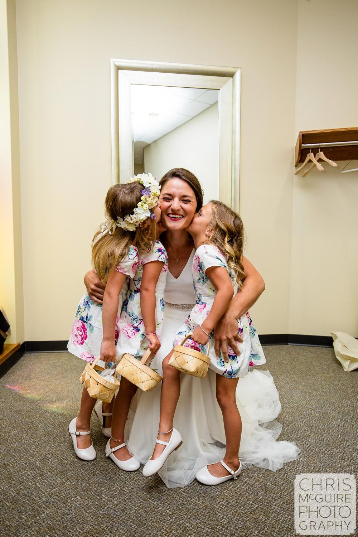 flower girls kissing bride