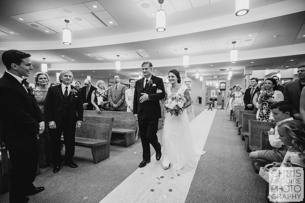 bride and father walk down the aisle at Blessed Sacrament Morton