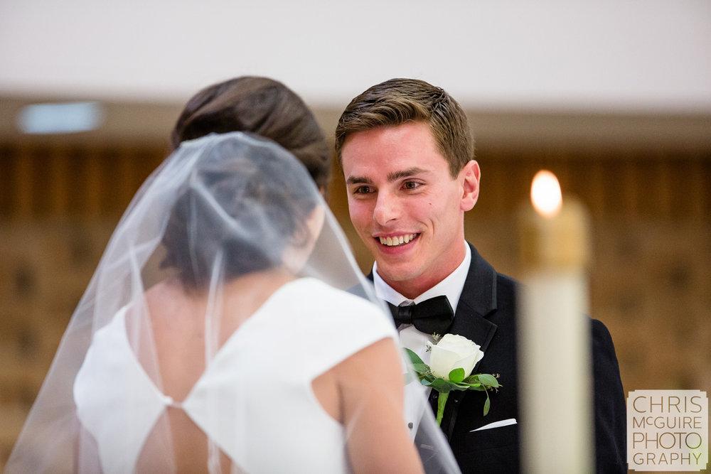 groom adores bride at Peoria IL wedding