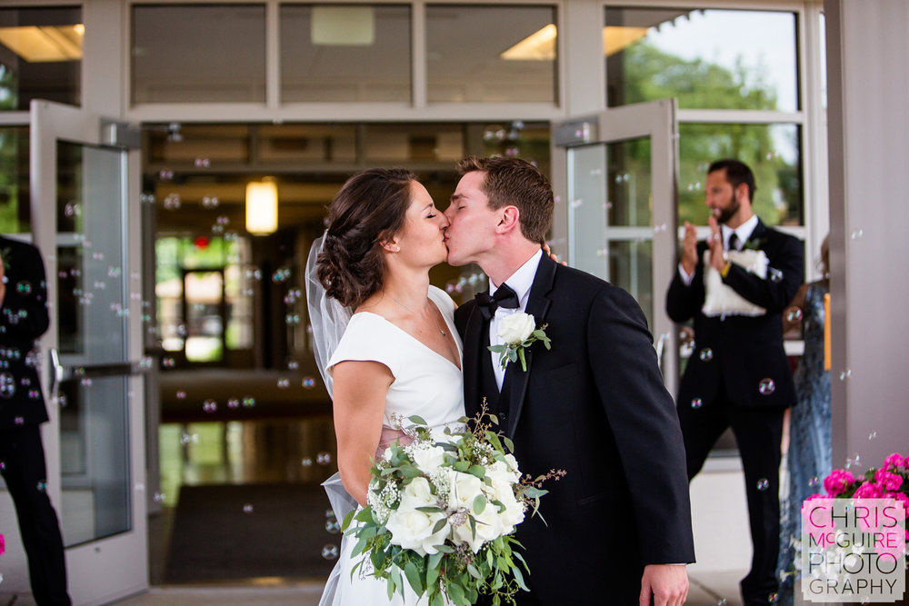 bride groom kiss with bubbles