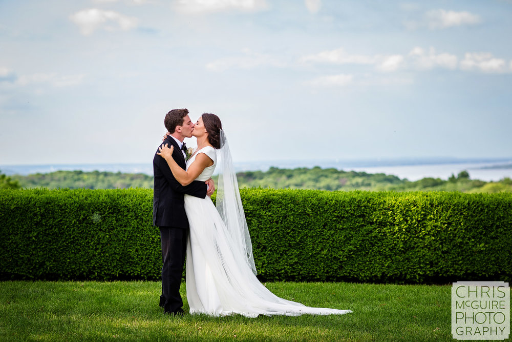 bride and groom kiss at grandview drive overlooking Illinois River in Peoria