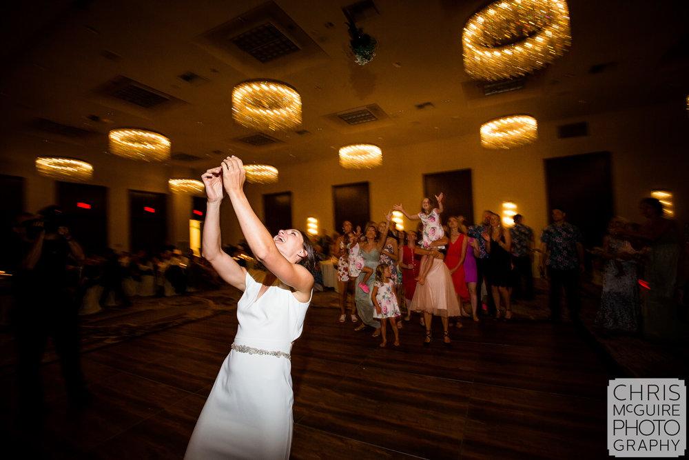bouquet toss at Pere Marquette ballroom wedding