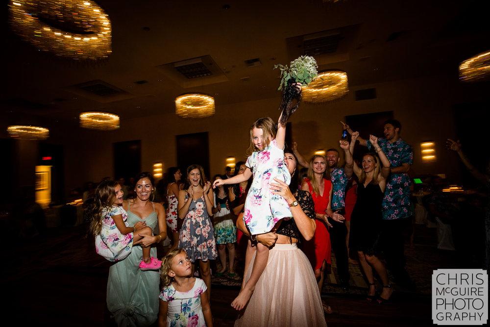 flower girl catches bouquet