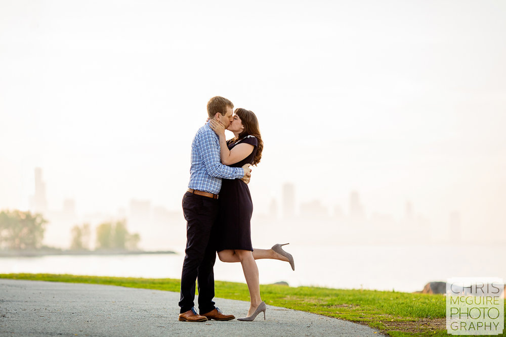 Chicago Engagement couple kissing at promontory point skyline