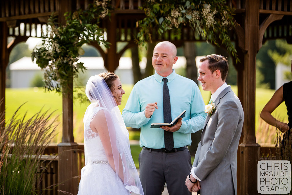 couple laughs during wedding ceremony central il