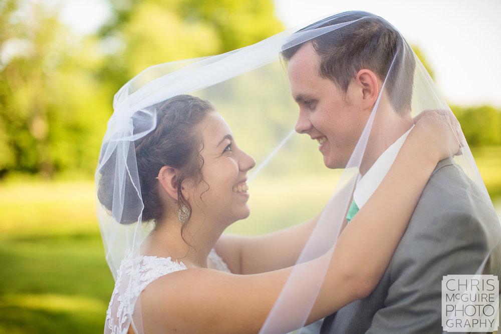 bride groom under veil peoria il