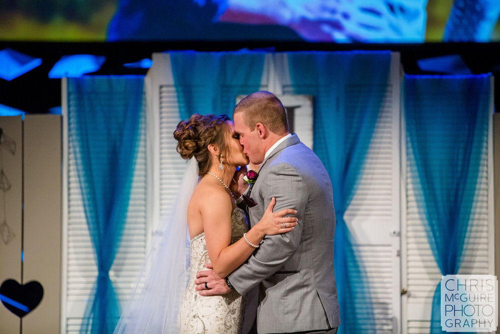 first kiss at Harvest Bible Chapel Peoria IL Wedding