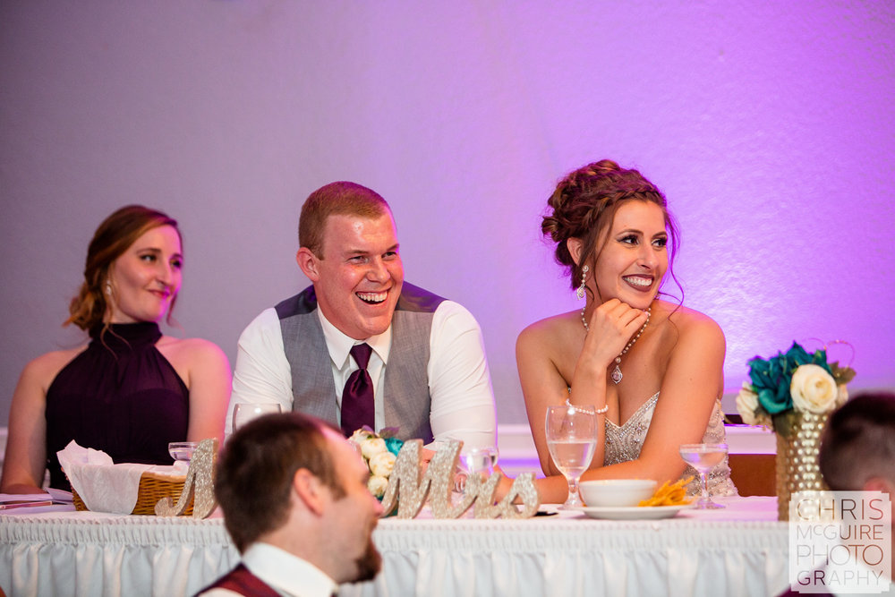 couple laughs during wedding toast