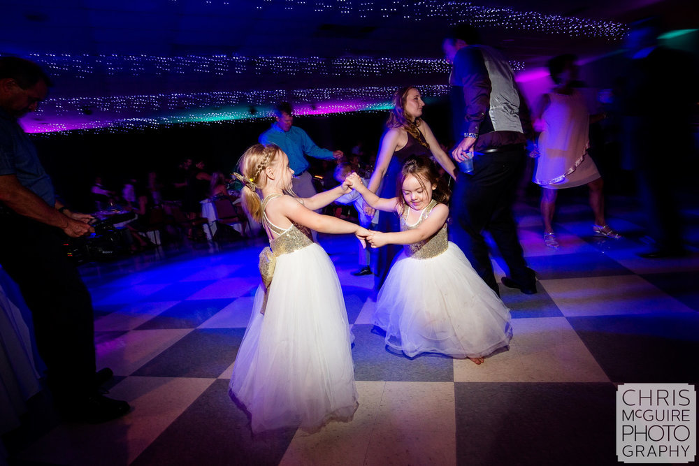 flower girls dancing at wedding reception