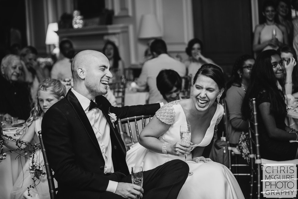 bride groom laugh during toasts at Allerton Mansion wedding