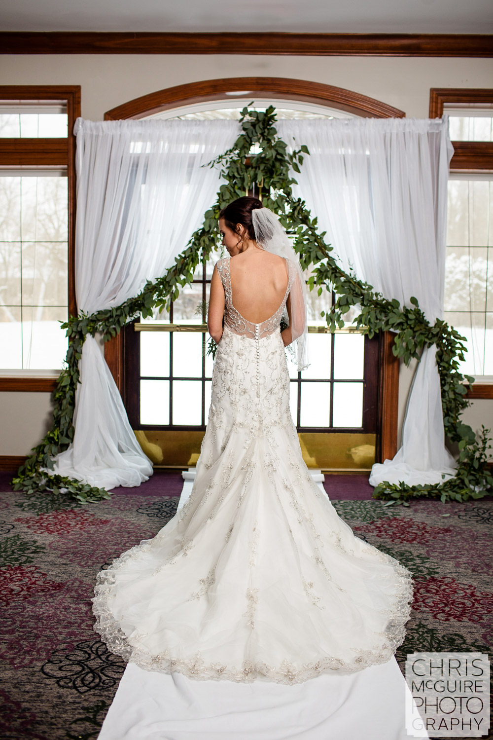 Bride backless dress at winter wedding