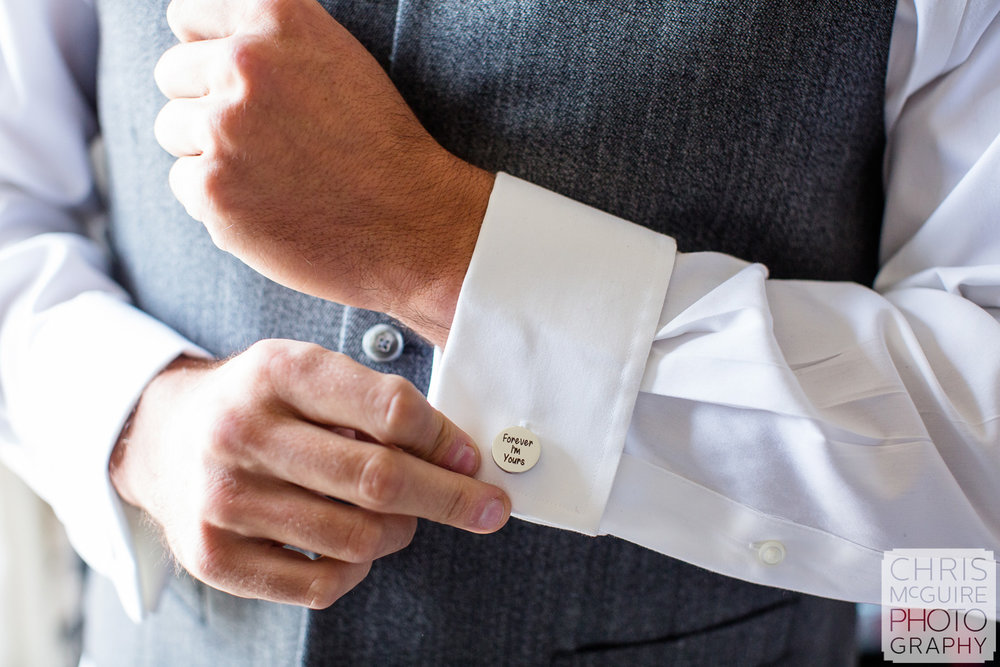 Groom shows custom cufflinks